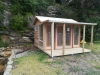 Verandah Cabana No.12 with cedar cladding, double doors & sidelights, added windows and custom bar