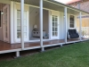 Verandah/Porch Design No. 20 with colonial door upgrade, added windows and custom side deck. painting and decoration by client