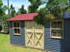 Melwood Verandah Cabana, no verandah, with cedar upgrade, cedar window upgrade, workshop doors, manor red colorbond roof. painting by client..jpg