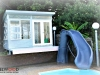 Melwood mod cabana pool cabana with custom cladding custom windows. after painting by client.jpg