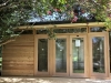 Mod Cabana No. 18 with cedar cladding, custom deck, double doors with sidelights and extra double doors