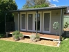 Verandah Cabana No.18 with cedar cladding, double doors and sidelights. Painting arranged by client.
