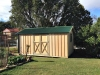 Workshed Design, No. 3254 in board and batten cladding, added workshop door, add down pipes and gutters
