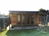 Mod Cabana No.18 with cedar cladding, 2 sets of double glass doors & custom verandah