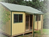 Melwood Verandah Cabana with custom verandah and guttering, added door and window. in standard board and batten cladding.jpg