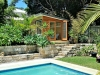 Mod Design No. 12 with cedar cladding, cedar doors and additional window. pool cabana.jpg