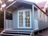 Porch Cabana 20 with custom double doors, double hung windows and after painting, steps and fitout by others.jpg