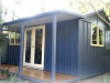 Verandah Cabana with added door and window, in board and batten after painting and stained deck .jpg