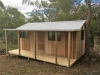 Verandah Cabana No.20 with board & batten claddiing, timber door and 3 aluminium sliding windows