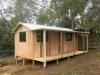 Verandah Cabana No.20 in board & batten with timber door & three sliding aluminium windows