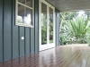 Verandah Design No. 18, Board + Batten Cladding, Electrical and paint work by client, Extended width of Verandah to 1.9m, Upgrade to Double hung window, upgrade to Double glass doors