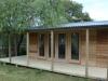 Verandah Design No.20 with cedar upgrade , added door and sidelights and two added custom windows.