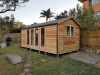 Cabana No.18 with cedar cladding, double doors and sidelights, sliding window. Freshwater, NSW