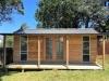 Verandah Cabana No.18 with double 10-light doors, cedar cladding and two double-hung mod windows