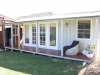 Verandah Design 20 with colonial door upgrade, added windows and custom side deck. painting and decoration by client