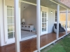 Verandah Design No. 20 with colonial door upgrade, added windows and custom side deck. painting and decoration by client