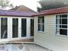 Verandah Design No.15 and No. 8 with no verandah, custom decking, cedar upgrade, added glass door and two glass side lights, added two double hung aluminium windows.jpg