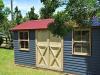 Melwood Verandah Cabana, no verandah, with cedar upgrade, cedar window upgrade, workshop doors, manor red colorbond roof. painting by client..jpg