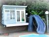 Melwood mod cabana pool cabana with custom cladding custom windows. after painting by client.jpg