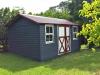 Verandah Design No. 19 with no verandah, upgrade to cedar cladding, add 2 double hung windows, add 1 workshop door. Manor Red Colorbond Roof. .jpg