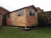 Workshed Design, No. 2654, extra windows solid four panel timber door, cedar upgrade, add gutters & Downpipes