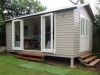 cabana 18 with cedar upgrade, extra glas doors and custom double doors, custom steps - painting and internal lining by others.jpg