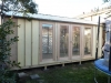cabana no19 with board and batten cladding and additional double glass doors.JPG