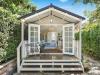 Porch Cabana No.20 with double 10-light doors, 3 double hung windows, internal wall and door