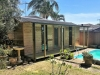 Verandah Cabana No.20 with cedar cladding, double glass doors and two double hung mod windows