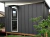 mod cabana in board and batten cladding painted in woodland grey with matching Woodland Grey Colorbond gutters and downpipes.jpg