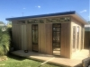 Mod Cabana No.18 with board and batten cladding, three double hung dinwos, double doors