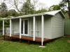 Verandah Design No. 20 with cedar upgrade added door and added window after painting and fitout by client.JPG