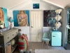 Kimberly's Backyard Art Studio features a storage section as well